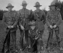 Some members of a crack demonstration platoon. Lieutenant Andrew, after being wounded, took in...