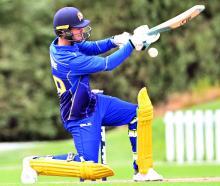 Otago Volts batsman Josh Finnie looks to ramp the ball.