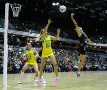 Australian Diamonds' Stephanie Wood (left) and New Zealand Silver Ferns Casey Kopua battle for...