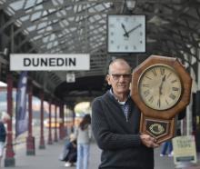 John Dore with a clock his father purloined from the Caversham railway station after a trip to...