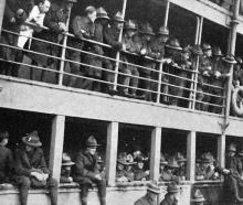 Returning soldiers line the railings on the Tahiti, awaiting their turn to disembark at Port...
