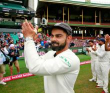 Virat Kohli acknowledges the crowd at the Sydney Cricket Ground after India's 2-1 test series win...