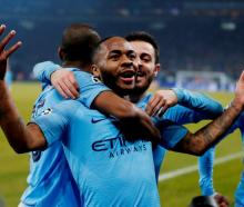 Manchester City's Raheem Sterling celebrates scoring their third goal. Photo: Reuters