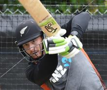 Black Caps opener Martin Guptill dispatches a delivery during a net session at the University of...