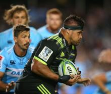 Chris Eves of the Hurricanes makes a break against the Waratahs. Photo: Getty