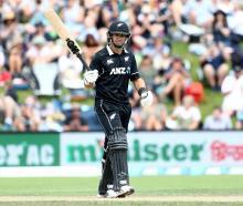 Ross Taylor celebrates reaching his half-century against Bangladesh at the University of Otago...