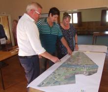 Beaumont residents inspect design plans for the new Beaumont bridge. Photo: Adam Burns