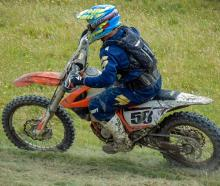 Jason Dickey on the way to claiming his second victory of the national motorcycling cross-country...
