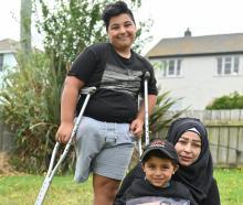 Pine Hill former refugees Nisrine (36), Kasem (14) and Mohammad (5) Zarzar in their garden after...