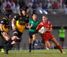 Joe Wheeler looks to stop former Crusaders team-mate and Kobe Steelers halfback Andy Ellis in a...