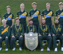 The champion Green Island cricket team with the Bing Harris Trophy, at Sunnyvale on Saturday....