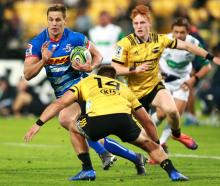 SP Marais of the Stormers is tackled by Wes Goosen of the Hurricanes. Photo: Getty Images