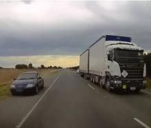 Terrifying footage has emerged of a driver coming inches away from colliding with oncoming...