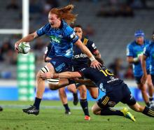 Blues flanker Tom Robinson makes a break against the Highlanders last Friday night. Photo: Getty...