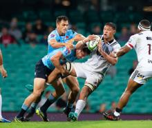 Crusaders player Whetu Douglas (8) looks to pass the ball in the match between NSW Waratahs and...