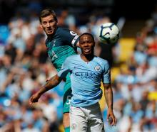 Manchester City's Raheem Sterling (R) in action with Tottenham's Jan Vertonghen. Photo: Reuters