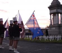Reverend Alex McLaughlin leads the dawn Anzac service at Balclutha Cenotaph this morning. PHOTO:...