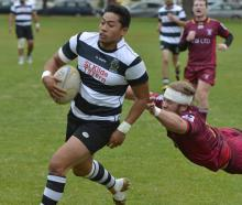 Southern centre Paul Tupai slips away from the tackle of Alhambra-Union flanker Tom Frood at the...