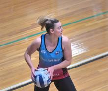 Gina Crampton gets ready to move the ball on at training at the Edgar Centre yesterday. Photo:...