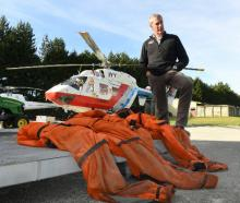 Sir Richard Hayes with the immersion suits that saved his workmates' lives. Photo: Stephen Jaquiery