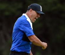 Brooks Koepka celebrates his victory in the PGA Championship golf tournament at Bethpage State...