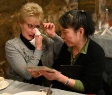 Ann Mee, a regular for the past 25 years, and the Asian's owner, Hong Juan Lee, share an...