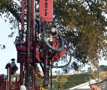 Peter Hopwood (left) and Jami Edgar, from McNeill Drilling, operate a deep soil drill at Tonga...