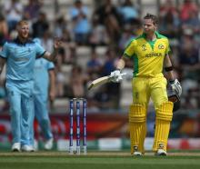 Steven Smith celebrates his match-winning hundred in a World Cup warm-up game against England....