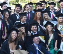 Graduates take part in the University of Otago graduation parade along George St on Saturday...