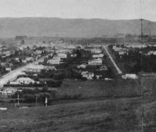 The growing township of Mosgiel with the woollen factory on the extreme right. - Otago Witness,...