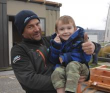 Cromwell builder Derek Craig and Harry Finch (4) give their approval to the building work in...