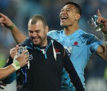 Cheika helped lure Folau back to rugby with the Waratahs in 2013, winning the Super Rugby title...