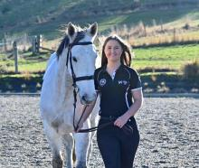 Outram rider Hollie Kooman gets in some training with her horse Silver Gamble in Outram yesterday...
