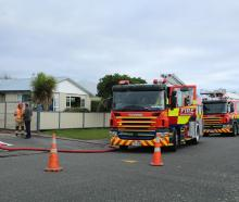 """Firefighters arrive at a """"well involved'' fire in the garage of a property in the Invercargill..."""