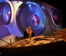Otago Museum exhibitions designer Shanaya Allan admires a scale model of the Titanic, as it...