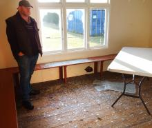 Waitaki Boys' High School property manager Neil Conway inspects damage to the school's cricket...