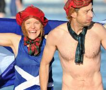 Proud Scots Karen Blackwood and Stephen Colpitts rise from the freezing waters of St Clair...