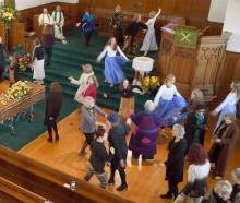 People express their love of movement at Shona MacTavish's funeral at Knox Church yesterday....