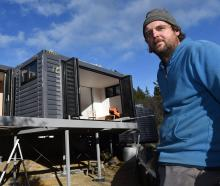 Toby Mann at his new Dunedin modular house, delivered 25 hours before this image was taken. Photo...