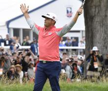 Gary Woodland celebrates after making a birdie putt on the 18th green to win the 2019 US Open...
