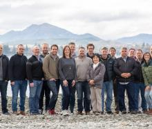 Xerra chief executive Steve Cotter (third from left) is surrounded by the rest of the 17-strong...