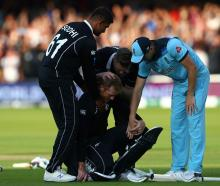 Black Caps Ish Sodhi and Jimmy Neesham are joined by England's Chris Woakes in consoling New...