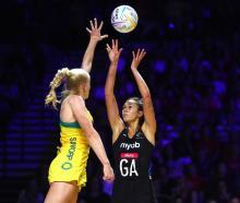 Australian defender Jo Weston tries to stop Silver Ferns shooter Ameliaranne Ekenasio from taking...