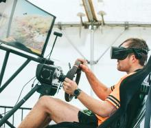Alan Harvey, of Oamaru, tests his skills in a virtual reality off-road driving simulator during...