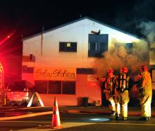 Smoke billows from the Satay Station restaurant in Kaikorai Valley Rd in Dunedin last night as...