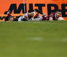 Southland first five-eighth Scott Eade scores a try in the tackle of Morth Harbour opposite...