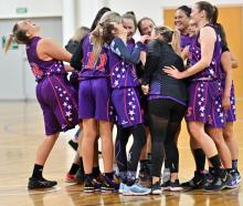 The South Pac Magic players celebrate their win over Ajax in the final of the Dunedin's women's...