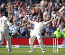 Ben Stokes of England celebrates with Jack Leach after hitting the winning runs to win the 3rd...