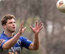 New Otago winger Henry Purdy is about to take a pass at Otago training at Logan Park earlier this...