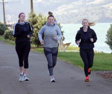 Friends (from left) Briar Waugh, Georgia Pringle and Ruby Pringle run along the cycleway-walkway...